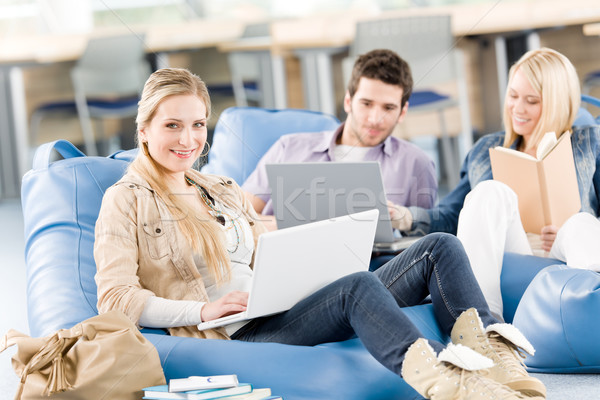 Group of high-school students with laptop sitting Stock photo © CandyboxPhoto