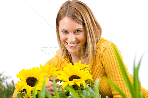 Stock photo: Gardening - portrait of smiling woman with sunflowers