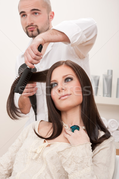 Stock photo: Professional hairdresser with hair dryer at salon