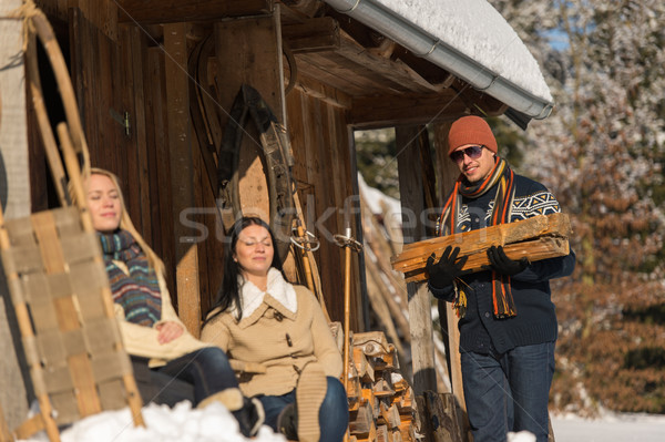 Young man carry wooden log winter cottage Stock photo © CandyboxPhoto