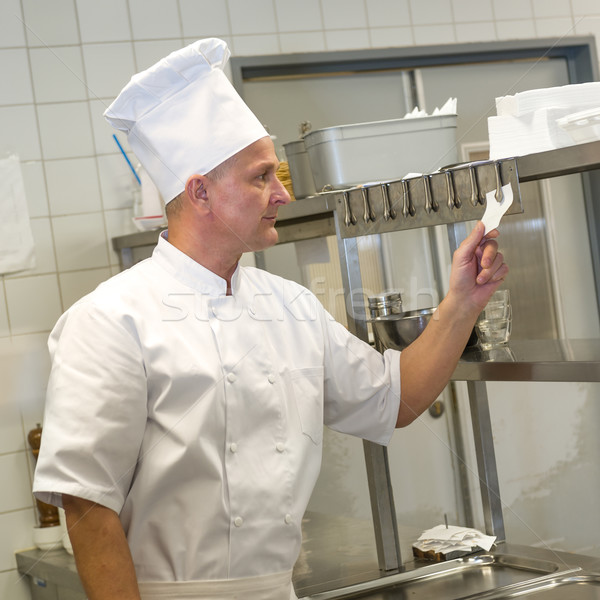 Chef reading orders in restaurant's kitchen Stock photo © CandyboxPhoto