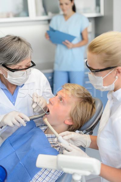 Dentista enfermera dentales tratamiento adolescente paciente Foto stock © CandyboxPhoto