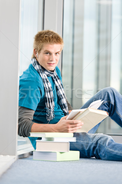 Young man with earbuds and books Stock photo © CandyboxPhoto
