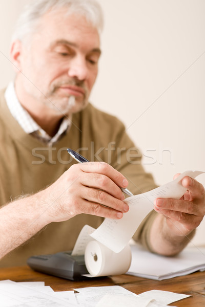 Senior mature man - home office, paper tape calculator Stock photo © CandyboxPhoto