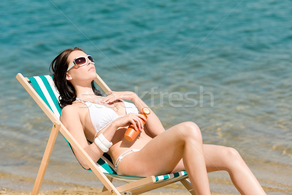 Summer young woman sunbathing in bikini suncream Stock photo © CandyboxPhoto