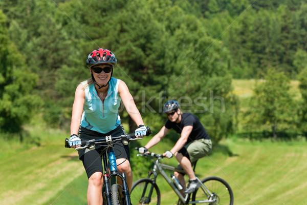 Sport mountain couple biking uphill sunny meadows Stock photo © CandyboxPhoto