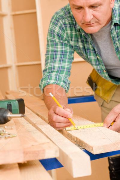 Handyman home improvement close-up of measure wood Stock photo © CandyboxPhoto