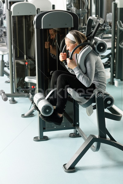 Fitness center senior woman exercise abs muscles Stock photo © CandyboxPhoto