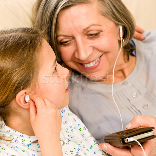Grandmother and young girl listen music together Stock photo © CandyboxPhoto