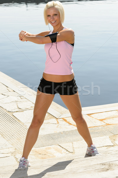 Fit woman stretch body by pier marina Stock photo © CandyboxPhoto