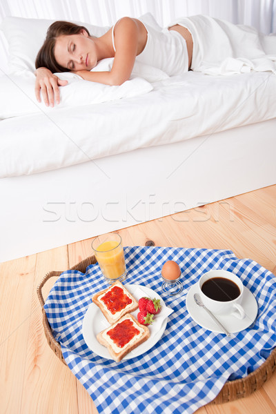 Woman having homemade breakfast lying in bed Stock photo © CandyboxPhoto