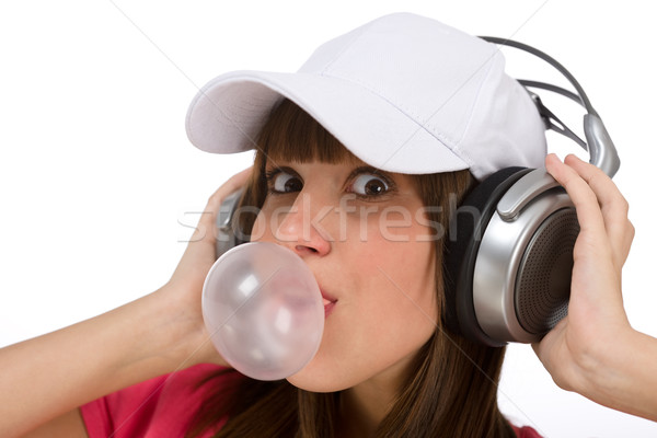 Happy teenager with bubble gum and headphones Stock photo © CandyboxPhoto