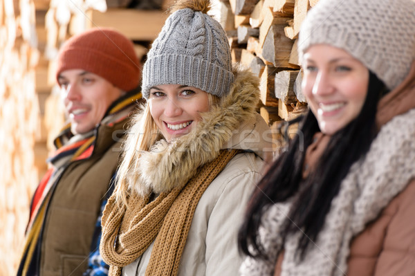 Three young people winter fashion wooden logs Stock photo © CandyboxPhoto