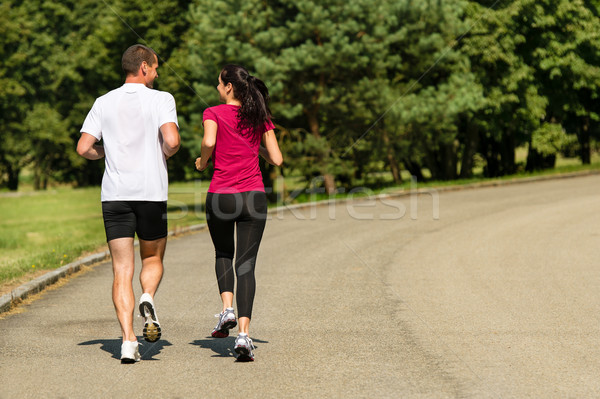 Rear view of jogging caucasian couple Stock photo © CandyboxPhoto