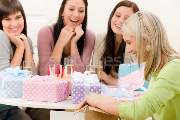 Birthday party - woman unwrap present, celebrating Stock photo © CandyboxPhoto