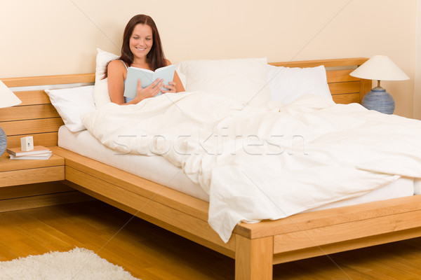 Bedroom - young woman read book in bed Stock photo © CandyboxPhoto