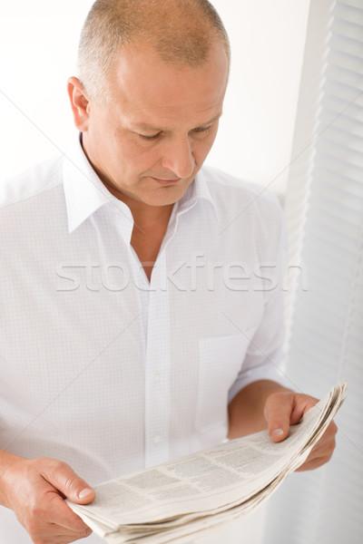 Senior businessman serious read newspaper portrait Stock photo © CandyboxPhoto