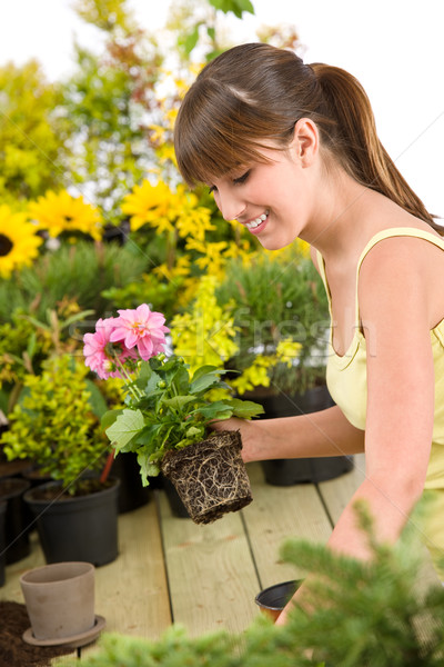 Gardening - smiling woman holding flower pot Stock photo © CandyboxPhoto