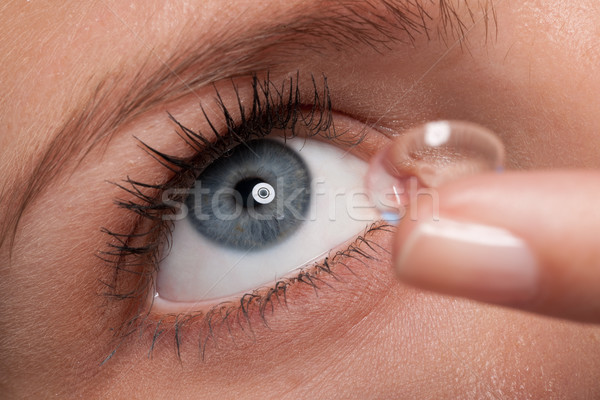 Close-up of blue woman eye with contact lens applying Stock photo © CandyboxPhoto