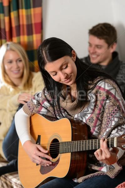 молодые друзей зима коттедж играть гитаре Сток-фото © CandyboxPhoto