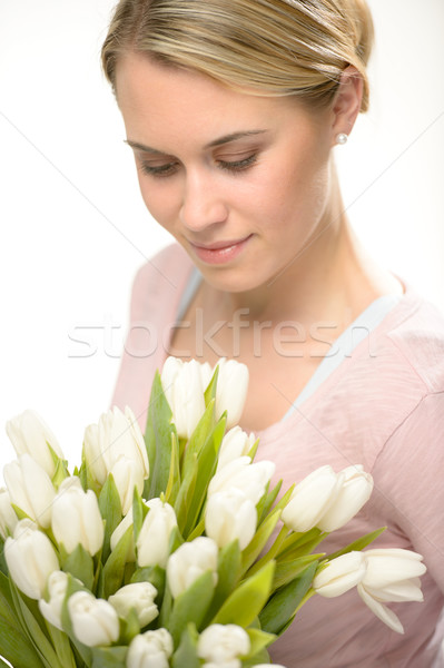 Lovely woman looking down white tulip flowers  Stock photo © CandyboxPhoto