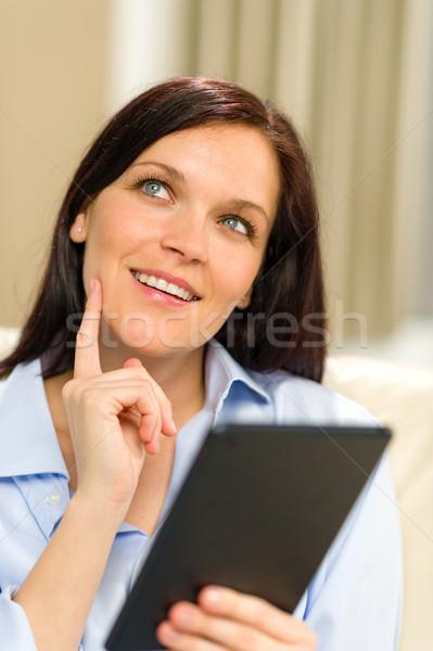 Zamyślony wesoły kobieta cyfrowe tabletka Zdjęcia stock © CandyboxPhoto