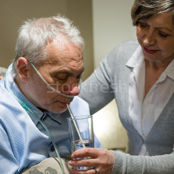 Nurse helping senior sick man with drinking Stock photo © CandyboxPhoto