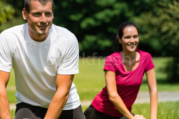 Close up portrait of couple stretching outdoors Stock photo © CandyboxPhoto