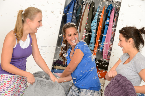 Young laughing girls during pillow fight  Stock photo © CandyboxPhoto