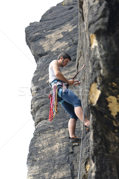 Rock climbing fit man on rope sunny Stock photo © CandyboxPhoto