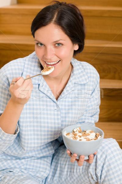Home ontbijt gelukkig vrouw pyjama eten Stockfoto © CandyboxPhoto