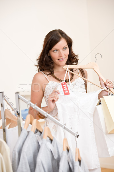 Fashion shopping - Happy woman choose sale clothes Stock photo © CandyboxPhoto