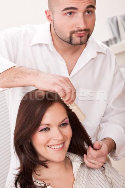 Stock photo: Professional hairdresser comb customer at salon
