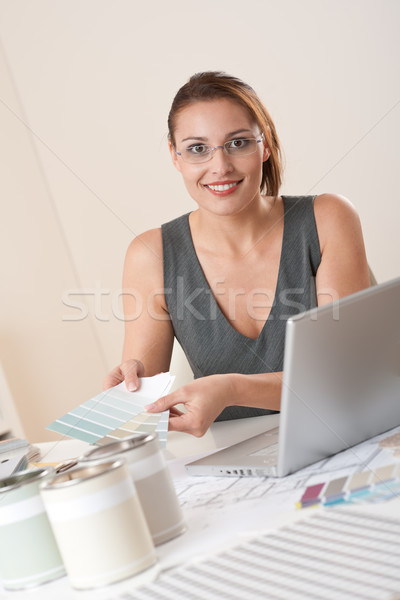 Stock photo: Young female designer working at office with laptop