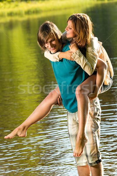 Lány háton lovaglás fiúbarát víz nevet Stock fotó © CandyboxPhoto