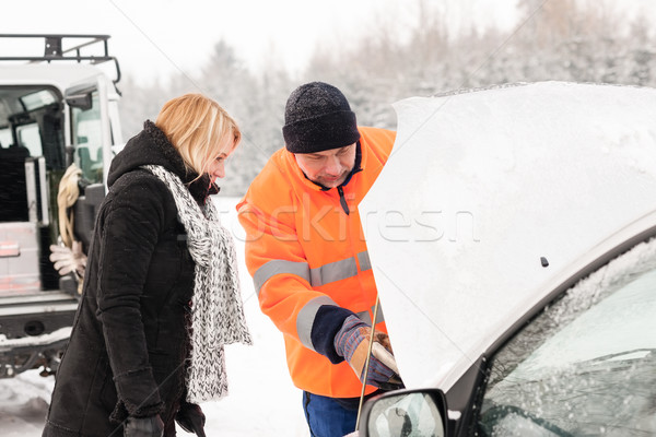 Woman mechanic looking under car hood snow Stock photo © CandyboxPhoto