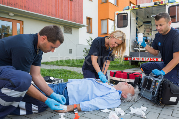 Paramedics giving firstaid to unconscious patient Stock photo © CandyboxPhoto