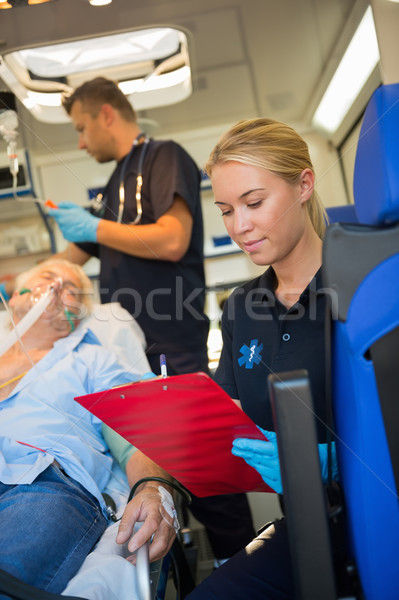 Paramedic assisting injured patient in ambulance Stock photo © CandyboxPhoto