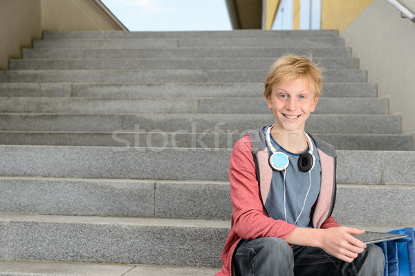 Happy student with tablet sitting on steps Stock photo © CandyboxPhoto