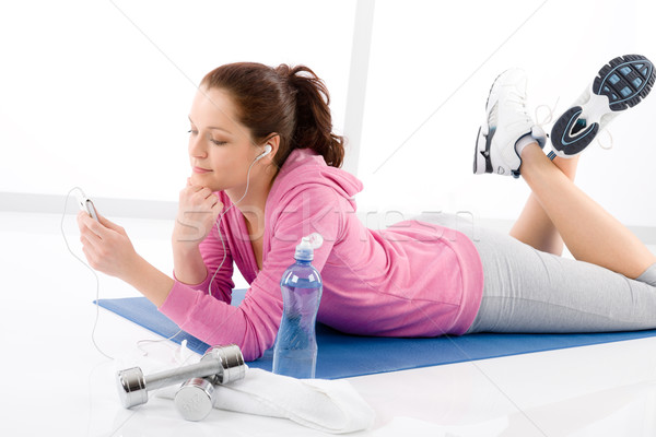 Fitness woman listen music mp3 relax gym stock photo © Jean