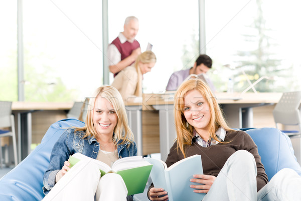 High-school students with mature professor read books Stock photo © CandyboxPhoto