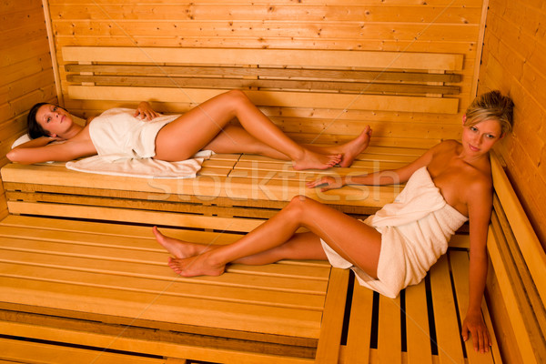 Sauna two women relaxing lying wrapped towel Stock photo © CandyboxPhoto