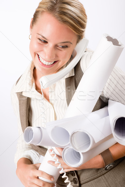 Young female engineer on phone carry blueprints Stock photo © CandyboxPhoto