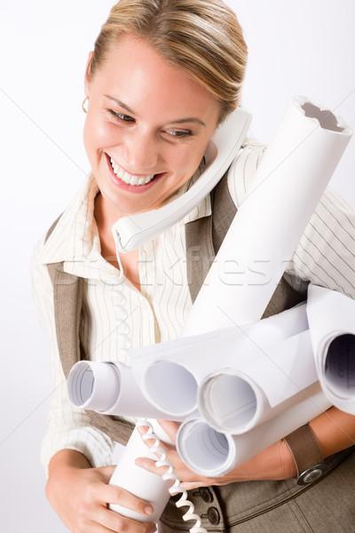 Jovem feminino engenheiro telefone blueprints Foto stock © CandyboxPhoto