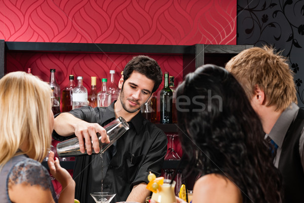 Barman prepare cocktail friends drinking at bar Stock photo © CandyboxPhoto