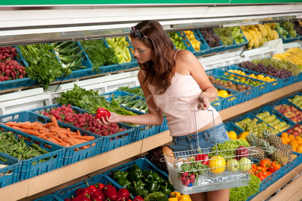 Grocery store shopping - Young woman buying vegetable Stock photo © CandyboxPhoto