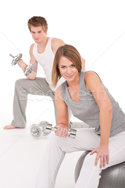 Young couple with weights and fitness ball on white Stock photo © CandyboxPhoto