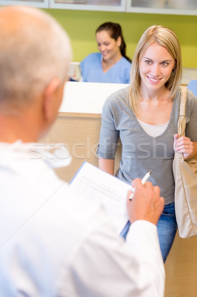 Dentist calling next patient for dental checkup Stock photo © CandyboxPhoto