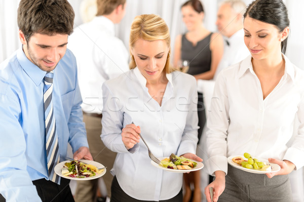 Business colleagues serve themselves at buffet Stock photo © CandyboxPhoto