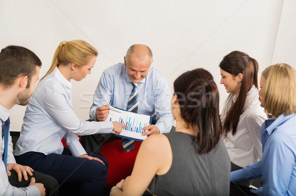 üzleti csapat megbeszél grafikon ül tárgyalóterem megbeszél Stock fotó © CandyboxPhoto